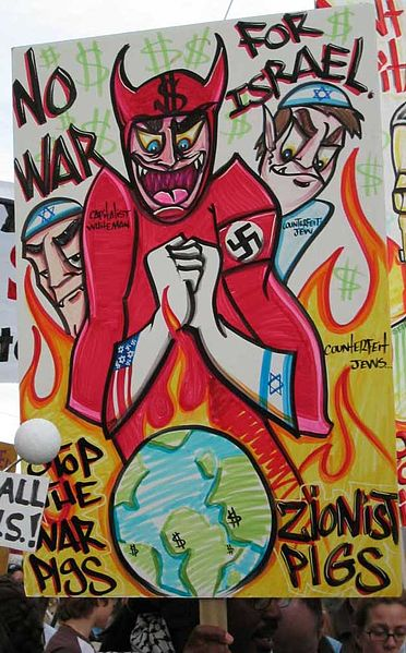 Poster held by a protester at an anti-war rally in San Francisco on February 16, 2003 (Wikimedia Commons)